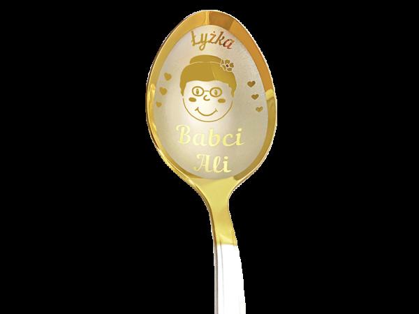 łyżka nierdzewna srebrne-złotego koloru z wygrawerowanym napisem Kochanej babci